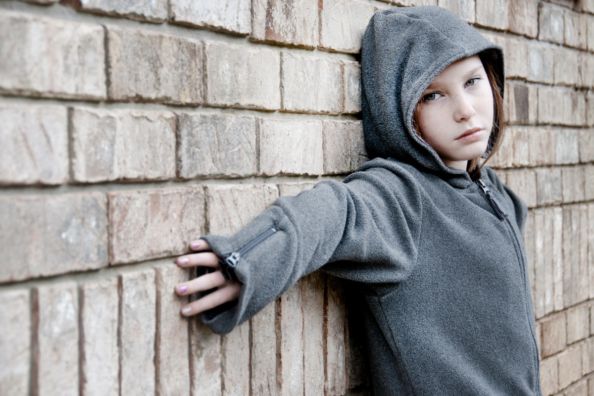 girl in hooded jacket outside 1200x800 - What are the signs and symptoms of substance abuse issues in adolescents?