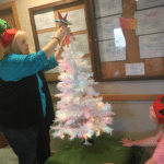 Shirley and Taylor, elves-in-training, hard at work decorating the 2016 Angel Tree!